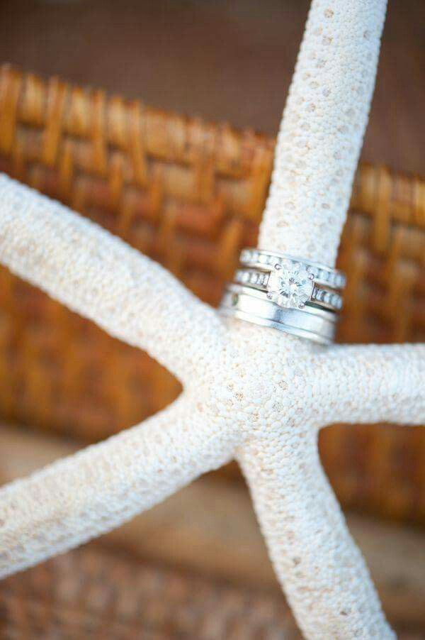 PERFECT!!!! I Want a beach wedding and this ring shot with one of my favs...starfish!