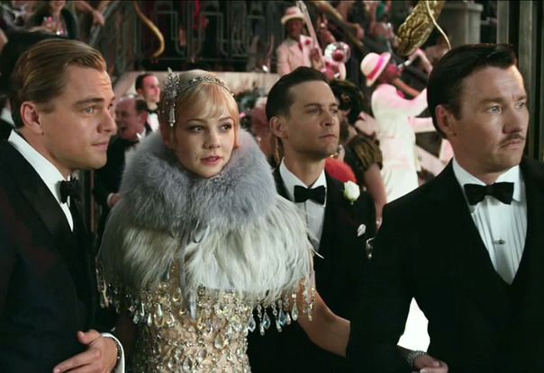 """Daisy Buchanan (Carey Mulligan), her fur and crystal draped coat as well as the gents of """"The Great Gatsby."""
