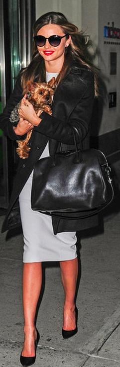 Miranda Kerr: Purse and coat – Givenchy,   Shoes – Manolo Blahnik