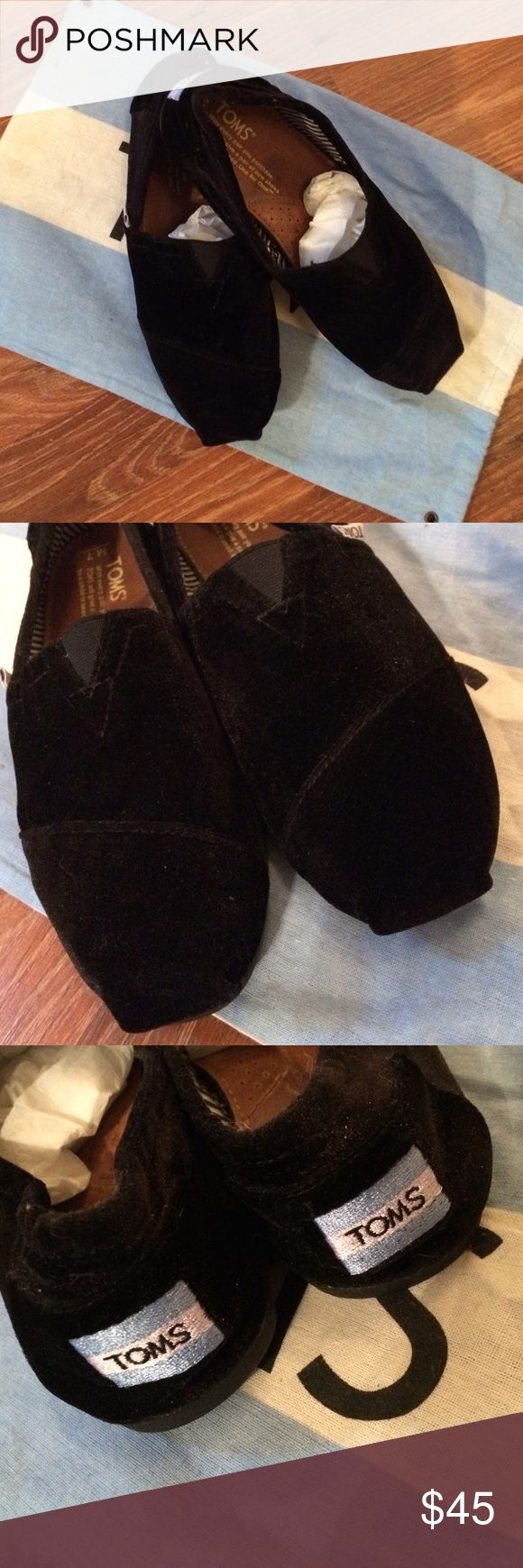 Velvet Toms These are so beautiful and plushy soft black velvet toms.  I wore them twice and have had them stored in their dust bag ever since.  Almost new so cute!!  These are a Men's 7, I wear a women's Toms and these fit me fine.  According to Toms comparison sizing Men's 7 is equivalent to Women's 8.5.  I will consider reasonable offers! TOMS Shoes Loafers & Slip-Ons