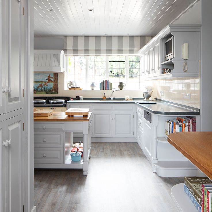 Grey accented kitchen with solid wood fittings