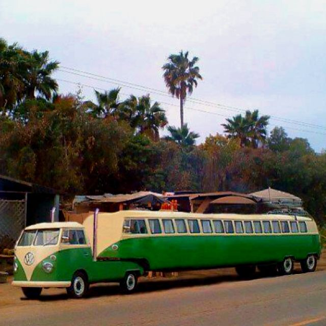 VW with Big Camper.