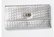 Silver Woven Clutch by Alibi at AlibiOnline. As seen in Oct issue of Who.
