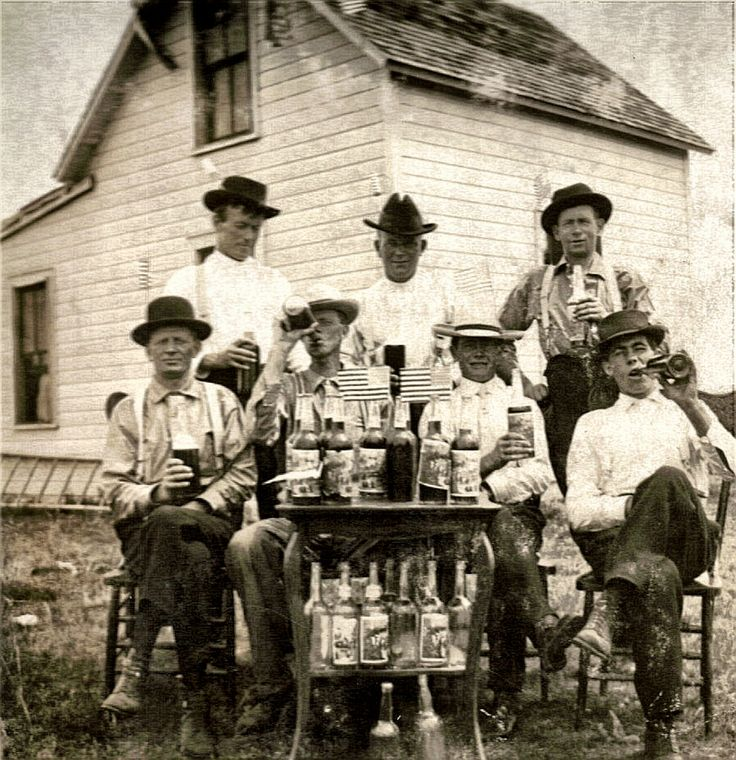 This is another photo stressing the prohibition era. The men in this photo had probably made the alcohol and were breaking many laws. Those who had done this in this period of time often sold the products to different suppliers. The alcohol for these man was a source of income. This photo captivated me because it seems like the men have a sense of family and belonging.