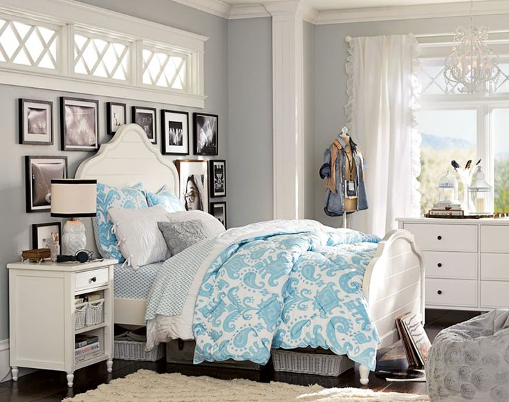 I love the pop of blue, dresser, bedside, and natural light but there is too much stuff on the wall.