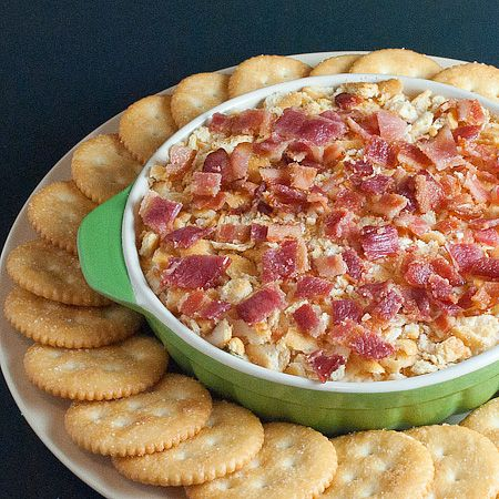 Charleston Cheese Dip (•1/2 cup light mayonnaise  •1 (8oz) package light cream cheese, softened  •1  cup shredded sharp cheddar cheese  •1/2  cup shredded Monterey jack cheese  •2  green onions, finely chopped  •Dash of cayenne pepper  •8  Ritz crackers, crushed  •6 slices bacon, cooked and crumbled)