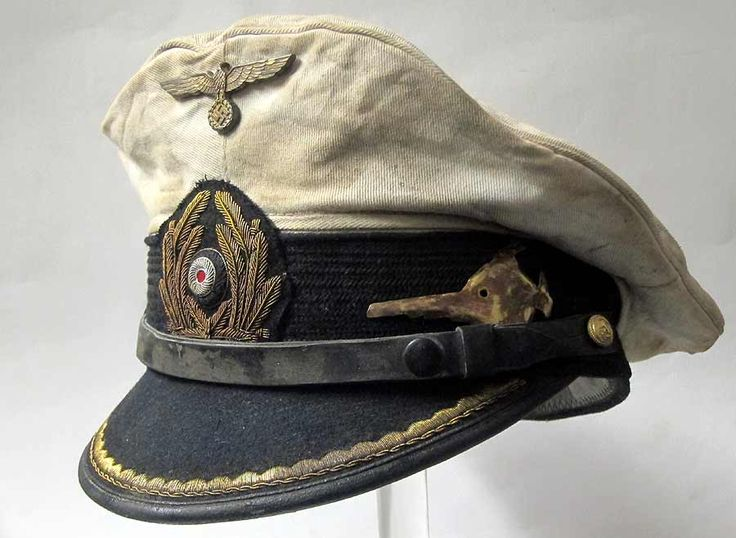 Reproduction German U-Boat Submarine Captains Peaked cap with 70+ years of ageing and numerous heavy oil stains and some worn and tarnished areas as worn by the Captain of U-96 Heinrich Lehmann-Willenbrock. Made famous by the film 'Das Boot'.