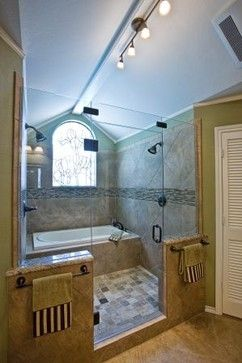 Love this wet room with two shower heads and bath (useful for pets and babies)