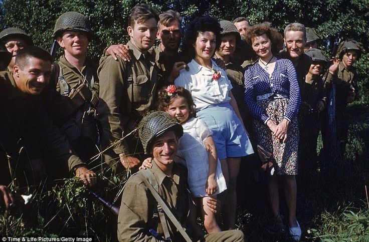 WW2 - French women and little girl with American troops, Normandy, 1944.  It's still is a surprise to me when I see these picture in such vivid colors.