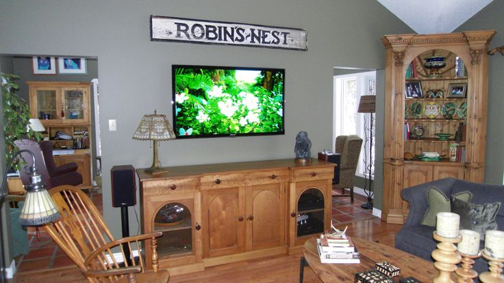 Wall mounted HDTV with Axiom speakers.