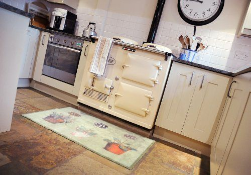 """Dirt Trapper Gripper Washable Design Mat approx 29"""" x 47"""" - Auriculas by Cotswold Mat Co Ltd. $114.95. Dimpled gripper backing to grip hard floors and give additional grip on carpets. 100% cotton pile to absorb 95% on wet and mud. Machine washable at only 40°C and tumble dryable.. 5 year guarantee. Made in the UK.. Approximate thickness 7mm. Ideal for doorways, kitchens, bathrooms, boats and especially pets. Made in the UK using a cotton rich pile which absorbs 95% o..."""