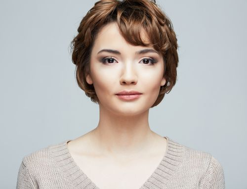 The Short Haircut Looks Stylish With A Few Wavy Strands