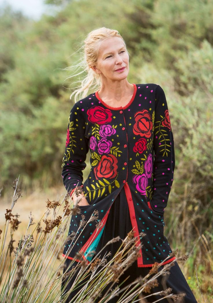 "The knitted ""Rosario"" long cardigan will be a jewel in your closet. Easy-to-wear longer style with pockets and finished with lovely ribbing. The buttoning edge is beautifully decorated a with woven grosgrain ribbon in a contrasting color and the buttons come in pretty colors."