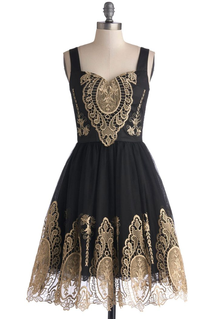In the Chandelier Light Dress. You wanted to surprise your friends by making a subtle entrance  but thats not so easy, when the chandeliers above instantly illuminate the golden embroidery of your black dress by Chi Chi London! #black #prom #modcloth