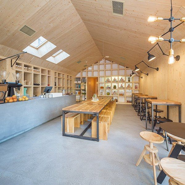 This cold-pressed juice bar in Romania's capital city has a decidedly Scandinavian feel. London-based architecture firm Not a Number created a minimalist black-metal exterior to set off warm spruce walls. Inside, a nearly 15-foot-long communal oak table is the central gathering place. The light fixtures and airy ceiling installation were sourced from Nordic countries—as is the shop's coffee and tea. facebook.com/frudisiac