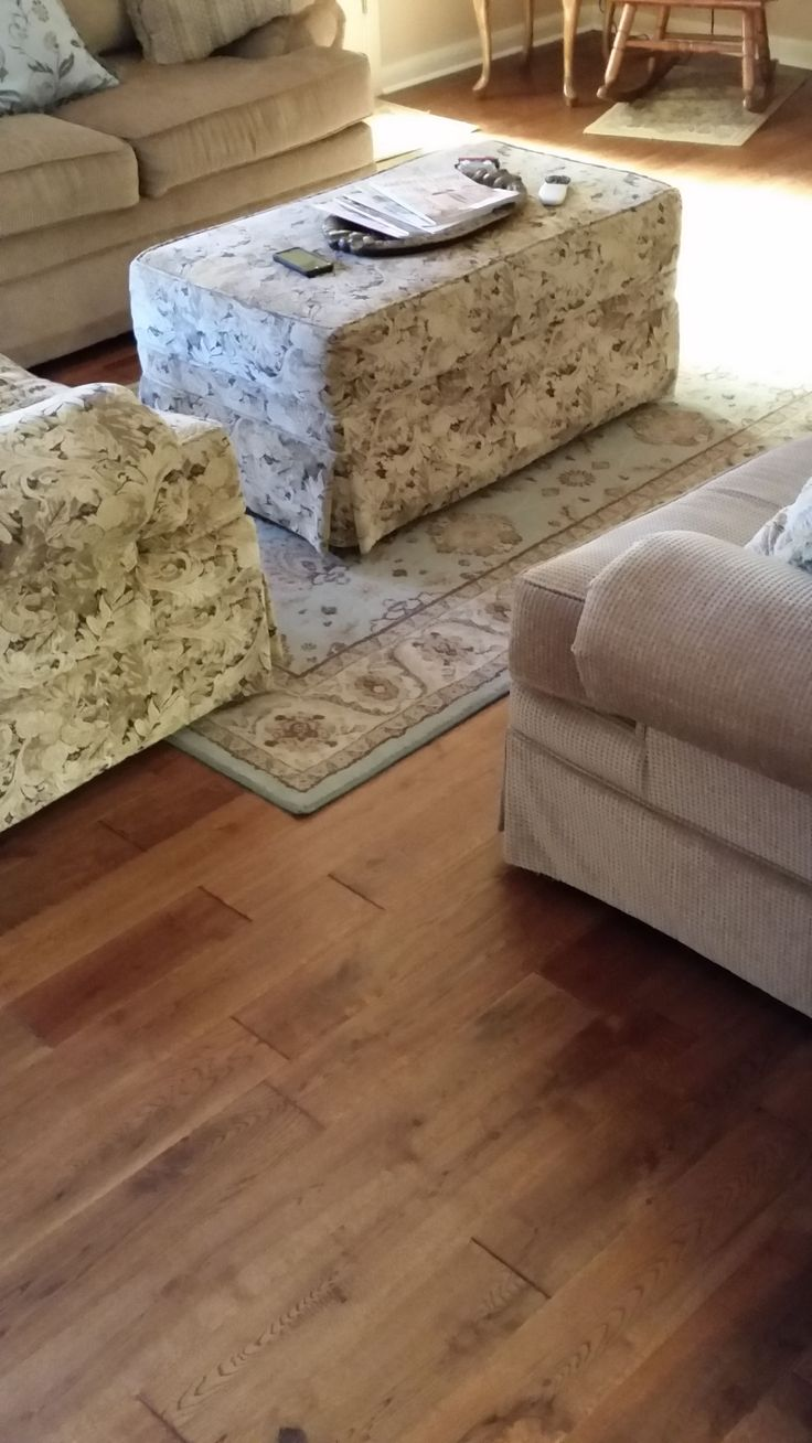"""Handscraped wide plank prefinished hardwood flooring.  Solid Red Oak with Saddle stain color.  4.75"""" wide by .75"""" thickness.  The Great Indoors, Inc. Cleveland, Georgia"""