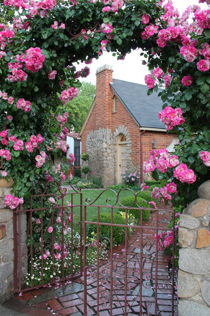 this home is in the city i live and the rose arch is always lovely....we just bought a rose close to this for our front gate using this as inspiration