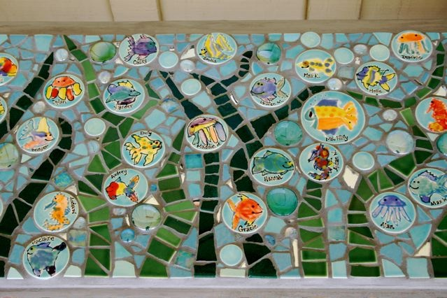 This one is neat.   It is SO adorable!  Various round bisque tiles, simple mosaic work looks amazing.  SB