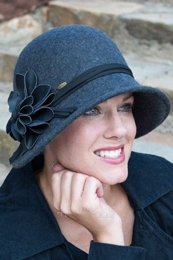 This fashionable cloche style hat offers a vintage look with a modern twist. The inside of the hat features a drawstring for custom size adjustment. 100% wool exclusive of decoration.