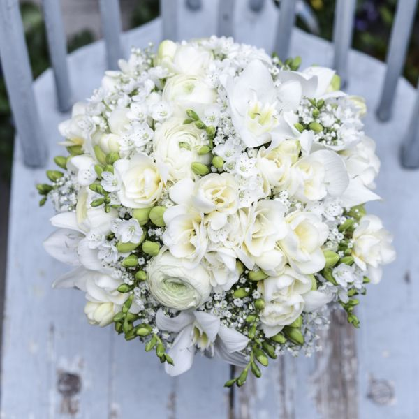 16 best white wedding flowers by florissimo images on pinterest romantic white wedding bouquet with lilies freesia babys breath and ranunculus junglespirit Choice Image