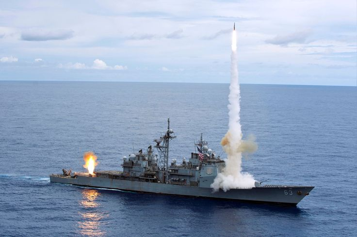 The Ticonderoga-class guided-missile cruiser USS Cowpens (CG 63) fires Standard Missiles (SM) 2 at an airborne drone during a live-fire weapons shoot.