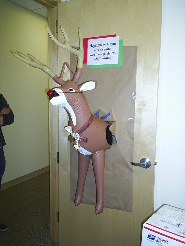 What a funny Christmas door decoration!
