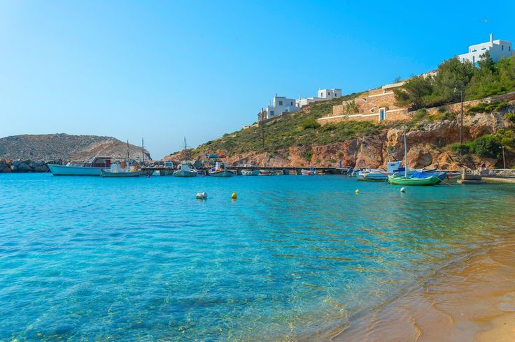 Achladi beach - one of the famous beaches in the southern part of Syros. Here, apart from crystal clear waters and golden sand, you will be able to enjoy water sports, as well as snorkeling and diving. #Greece #Syros #Terrabook #GreekIslands #Travel #Aegean #GreeceTravel #GreecePhotografy #GreekPhotos #AegeanSea #Traveling #Travelling #Holiday #Summer