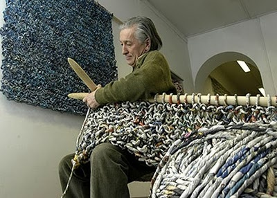 Italian sculptor, ecologist and performance artist Ivano Vitali, creates colour-coded balls of yarn from the daily newspapers and, using hand-made knitting needles, weaves extraordinary full-size creations worthy of a Parisian catwalk.