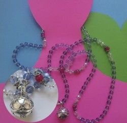 This is SUCH a pretty Mala!  blue topaz, pink agate & a silver harmony ball. Blue topaz brings about a feeling of calm by warding off chaos & negative emotions, allowing space for new wonderfulness into your life. The harmony ball is traditionally worn by pregnant women & the soft tinkling of the bell is thought to calm the mother & child. But that's not to say we need to be pregnant to wear this! & the bell, it's just so cute! http://misssallysmith.com/?page_id=843