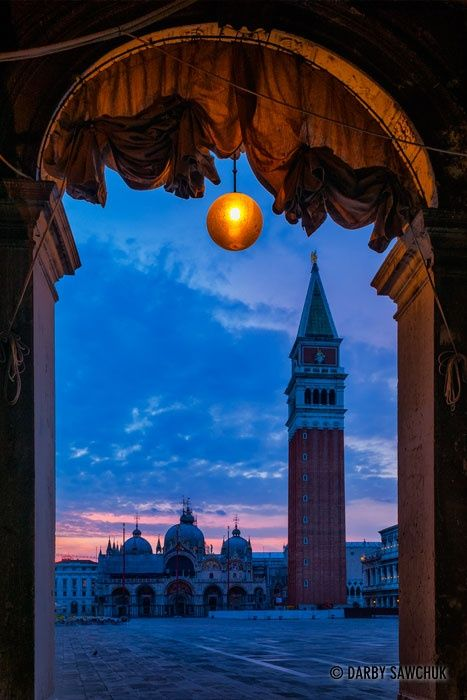 St. Marks Square, St. Marks Basilica and Campanile at dawn. Italy