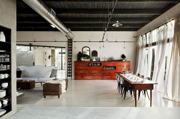 Old sprinkler-styled track lighting inside the spacious loft home