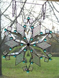Teal Blue Snowflake - Holiday Stained Glass Suncatcher. $72.00, via Etsy.