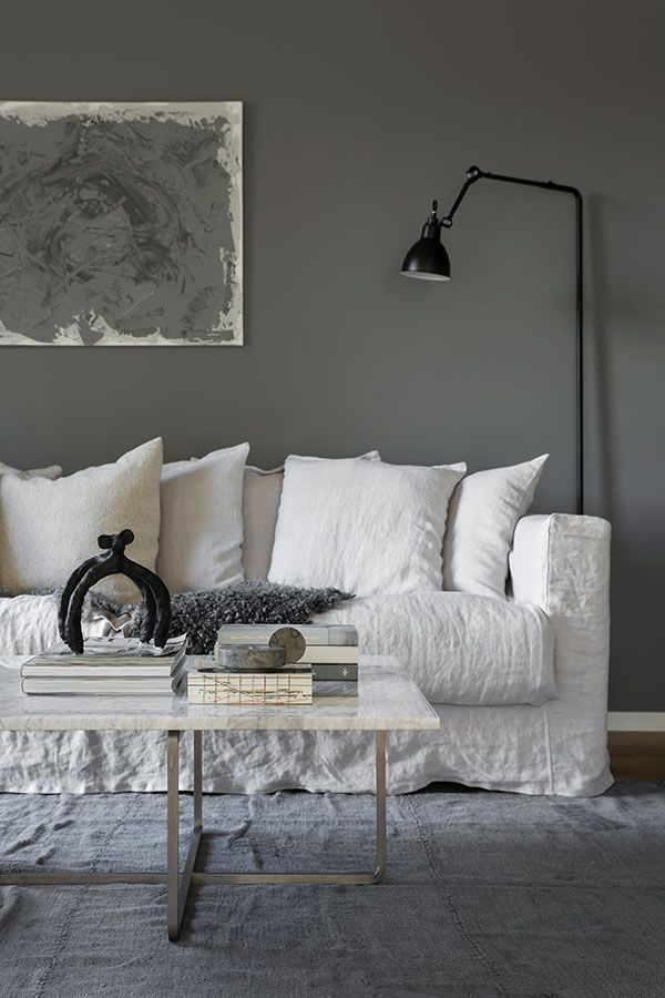 Le Grand Air linen sofa in a cocoon-like Swedish home in dark grey