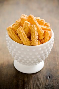 Paula Deen Cheese Straws are amazing. You must bake them just until brown, and I recommend parchment paper