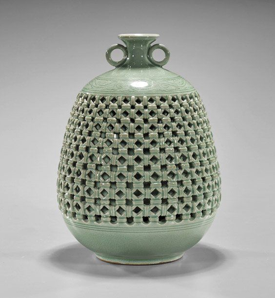 """Korean celadon glazed porcelain jar; of oval form with small mouth and two loop handles, reticulated basket weave design to body and interior cylindrical bottle; signed; H: 9 1/2"""""""