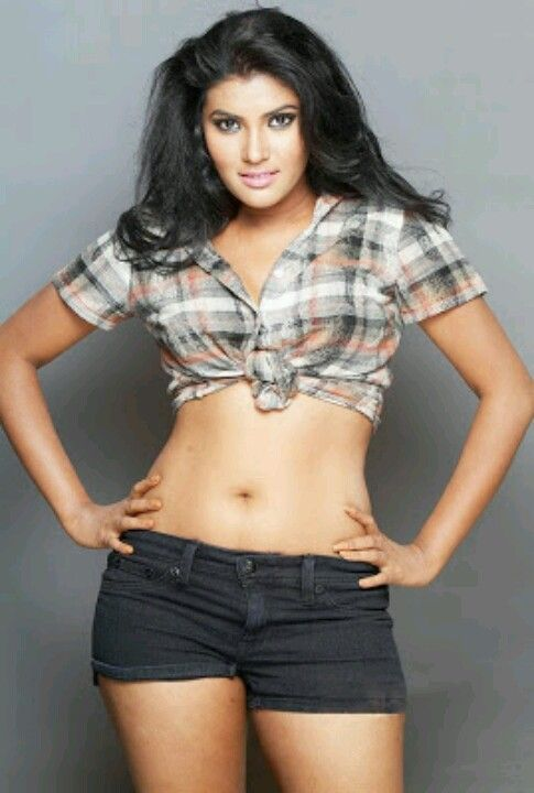 Hot south Indian beauty posing in modern costume like boy in shirt and mini shorts revealing her navel and hot thighs ----- RHYTHAMIKA -----