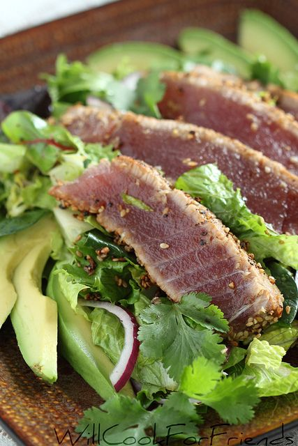 Sesame crusted, pan seared Ahi tuna on a bed of fresh greens, lightlytossed with honey/lime/ginger dressing