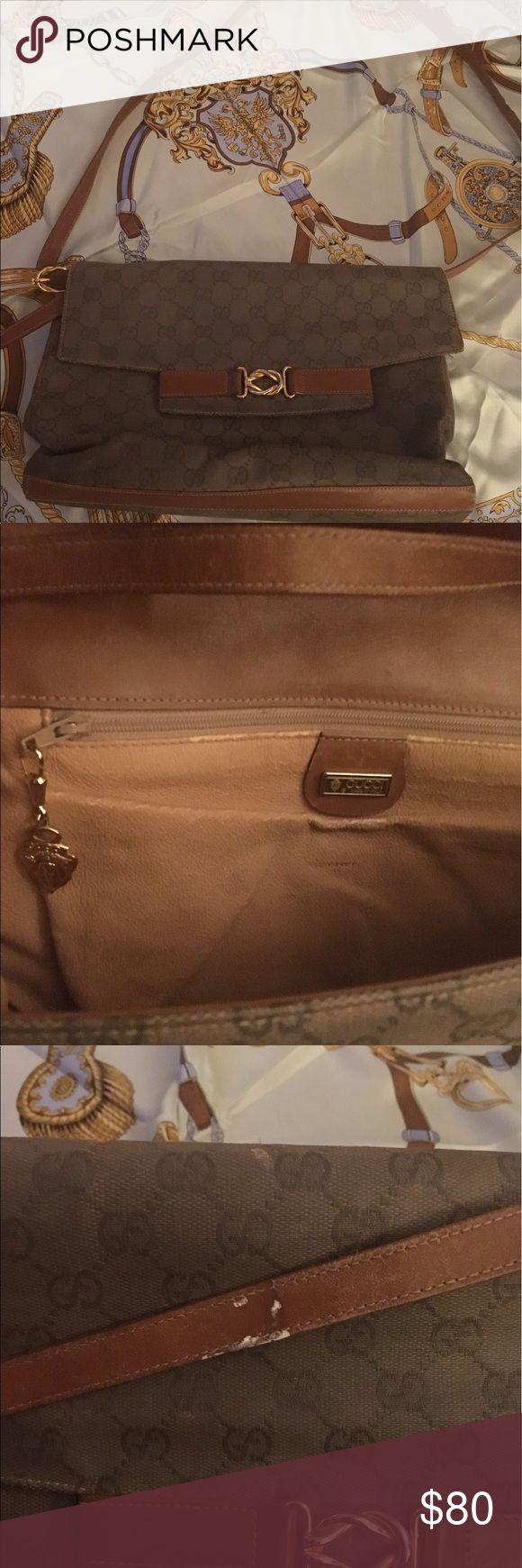 Vintage Gucci handbag Authentic brown Gucci bag with gold details. Previously  owned; used condition and could use a good cleaning ( as shown in picture) price referents this classic second hand purse. Gucci Bags