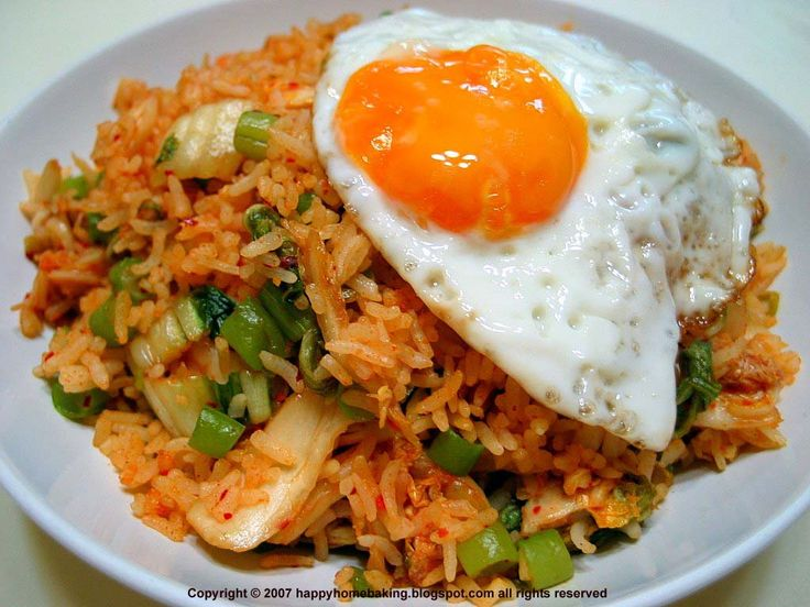 """Nasi goreng, literally meaning """"fried rice"""" in Indonesian, can refer simply to fried pre-cooked rice, a meal including stir fried rice in small amount of cooking oil or margarine, typically spiced with kecap manis (sweet soy sauce), shallot, garlic, tamarind and chilli and accompanied with other ingredients, particularly egg, chicken and prawns. (WIKIPEDIA)"""
