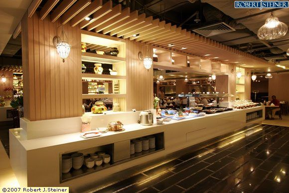 Restaurant buffet counter with 2 pillar on right and for U design hotel