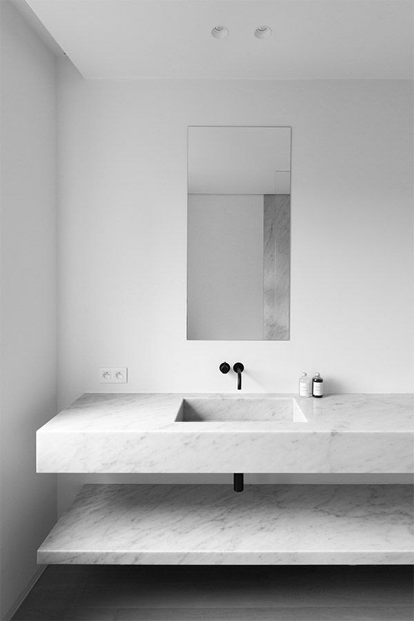 white + marble + black fixtures + floating sink + minimal bath