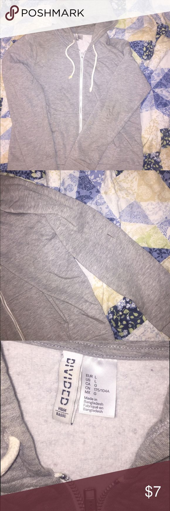 Women's Zip Up Hoodie Grey hoodie. There's a black crayon drawing on left sleeve & the right drawstring is a lil dirty it just needs to be washed but it's my sisters so she doesn't really want it anymore. Price is firm & as low as she will go  🕘Purchased date : Unknown  ✅Condition : 5/10 🚛 Ship Time : Same Day or Next 😄Feel free to comment or share!! H&M Jackets & Coats