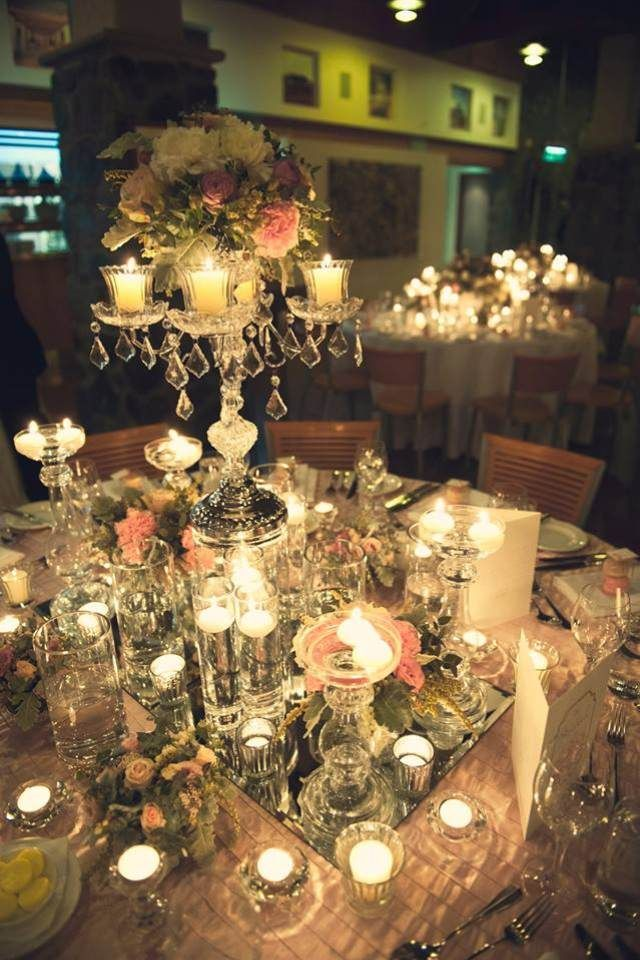 The Bridal table was styled with an extra a touch of opulence by adding a vintage glass candelabra set high above the table. The base of the centrepiece was styled with plenty of florals, candles and a dusty pink french pleated table cloth.