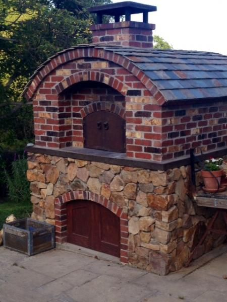 """We finally put the finishing touches, slate roof, steel doors, on our 42"""" Pompeii style wood fired oven. To view a slideshow of our build goto: https://www.youtube.com/watch?v=wWHPC30w_JY&feature=youtu.be rbhumberth?v=wWHPC30w_JY&feature=youtu.be."""