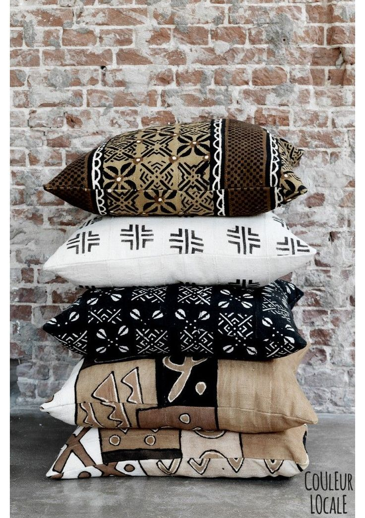 Bogolan Cushions. Bogolan is the name for a cotton fabric, traditionally dyed with fermented mud from the Niger and other natural dyes such as bark and plants. In traditional bogolan production, men weave the cloth and women dye it.....click for more