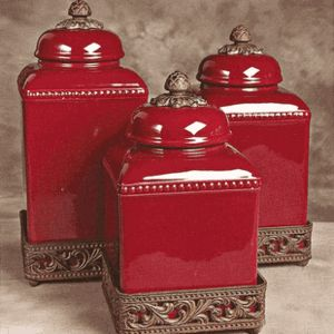 Red Tuscan style canisters.... you could add some canisters like this in the kitchen. It's still a bit traditional but would look nice with your cabinets. Of course you wouldn't choose red but this is the best I could do in terms of the style.