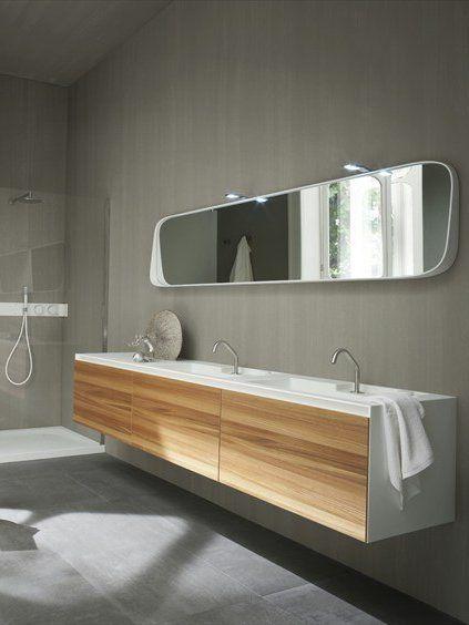 Wall-mounted Corian® washbasin unit with doors, design by Giulio Gianturco (2012)
