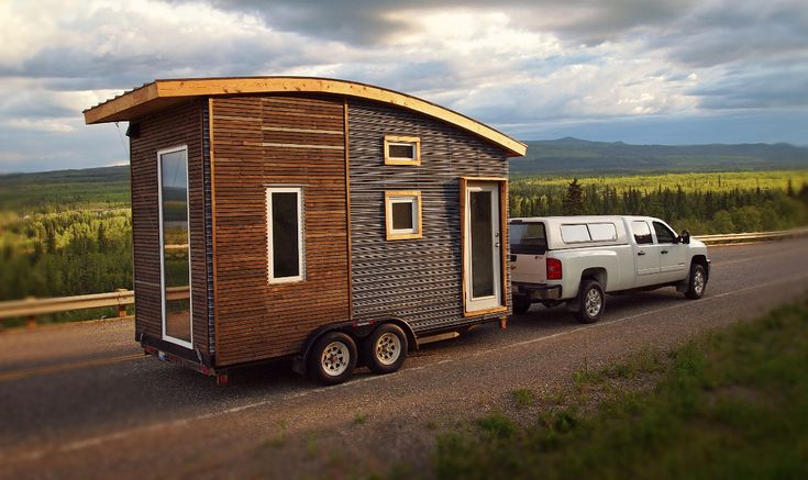 Version.1 was the tiny house that started it all. Built on a shoestringbudget for justunder $20,000, this 16′ tiny house featured reclaimed materials, open joint rainscreen siding with lifetime treatment,a Dickinson propane fireplace, natural finishes and non-toxic materials.Systems included a bucket toilet based the Humanure book, an instant propane tankless heater, a small stove/oven, passive solar design, and a birch plywood interior finish.Sold for $21,500. On a 20′ trailer…