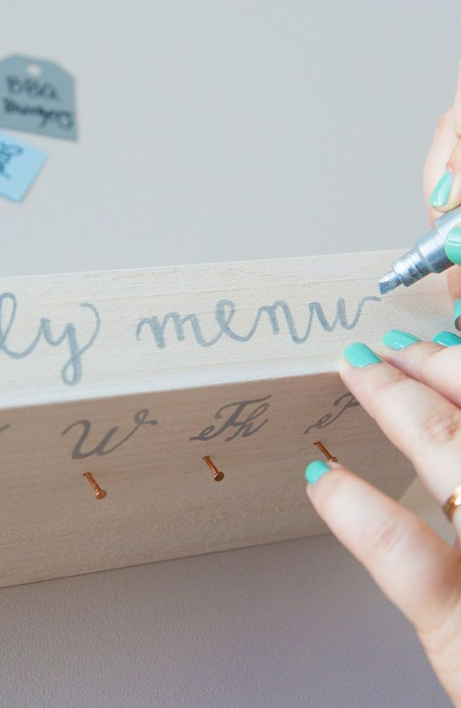 Keep your family organized with this DIY Menu Board! Plan meals, make lists and keep everyone on the same page in one place. Plus, you just need a few simple materials. Click in for our full guide.