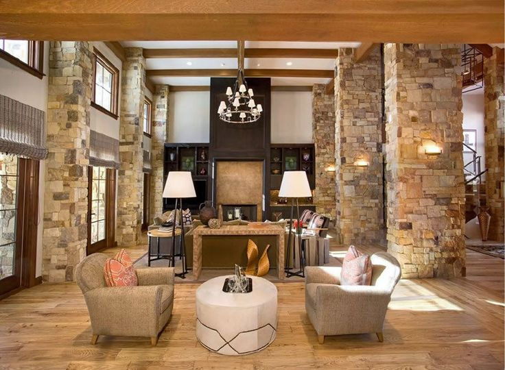 stone columns and massive beams frame this great room a new home by clevelands premier - Great Room Design Ideas